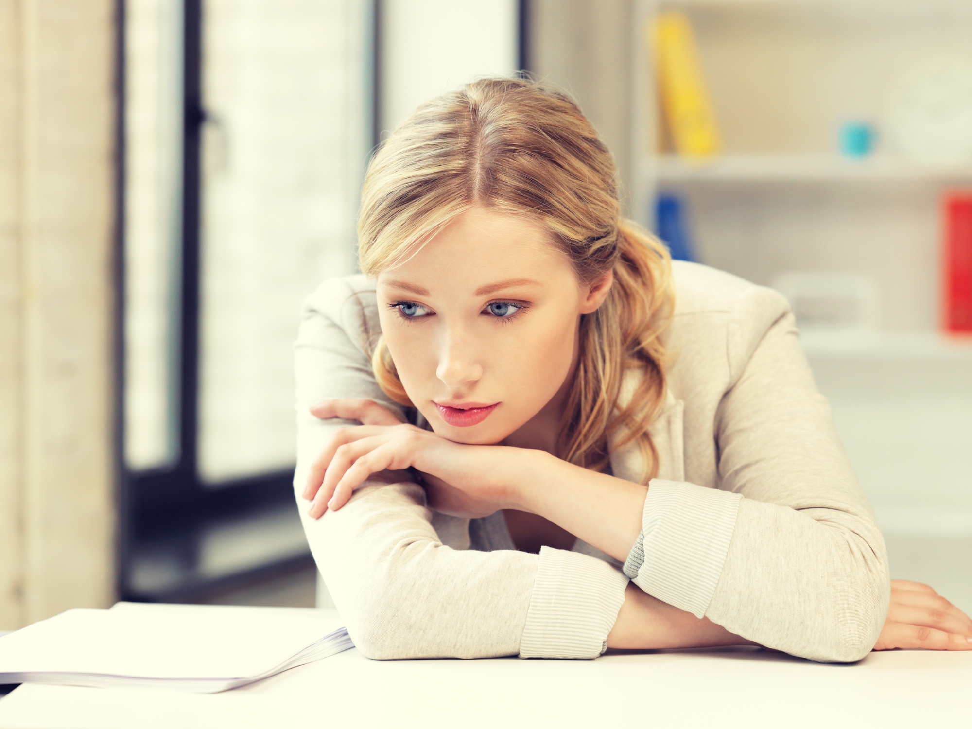 bright picture of unhappy woman in office