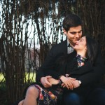 beautiful girl and her boyfriend resting together on a bench in the park
