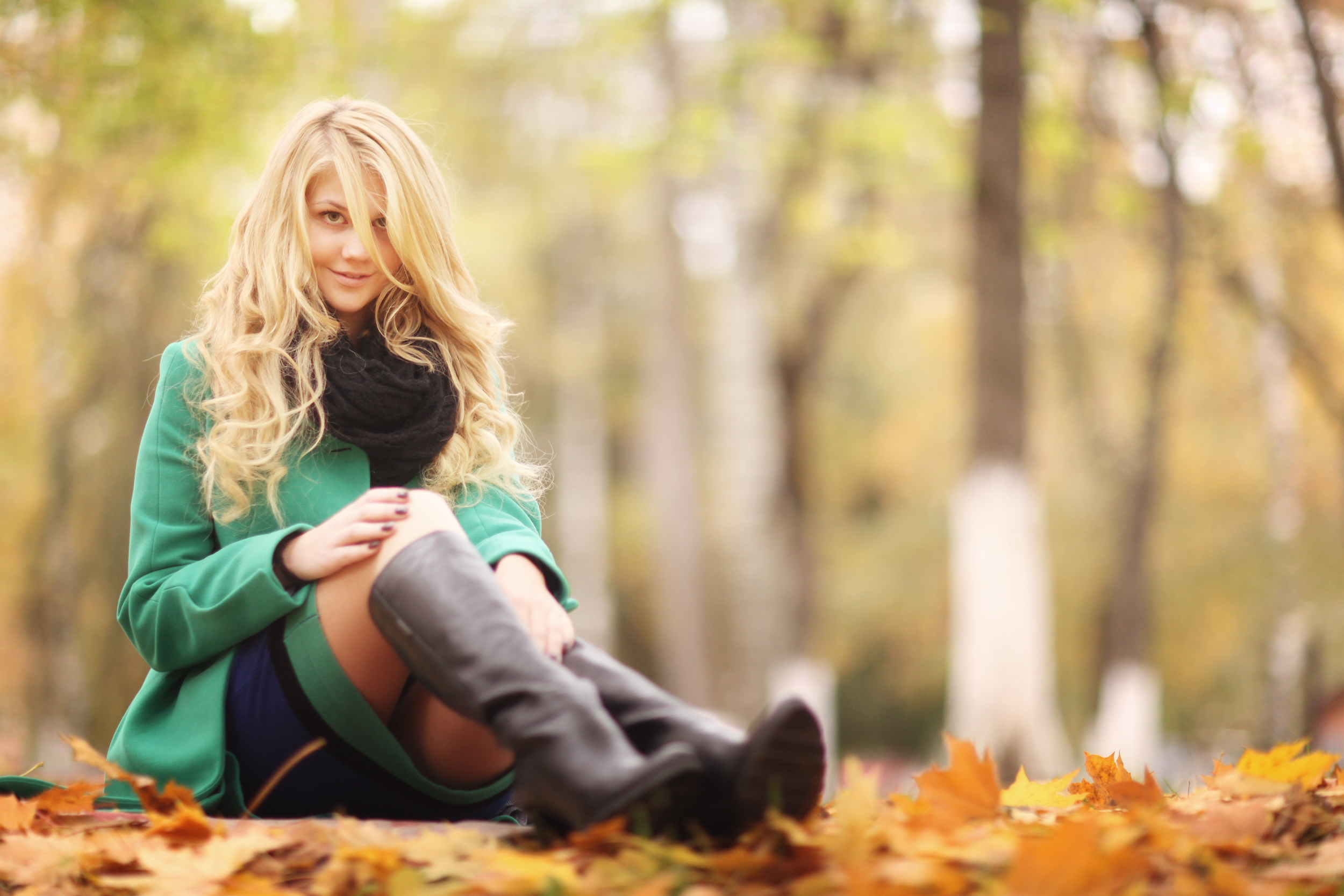 beautiful happy blond woman in autumn park