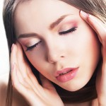 Dreamy sensual beauty - fresh young woman face, natural make-up. Headache