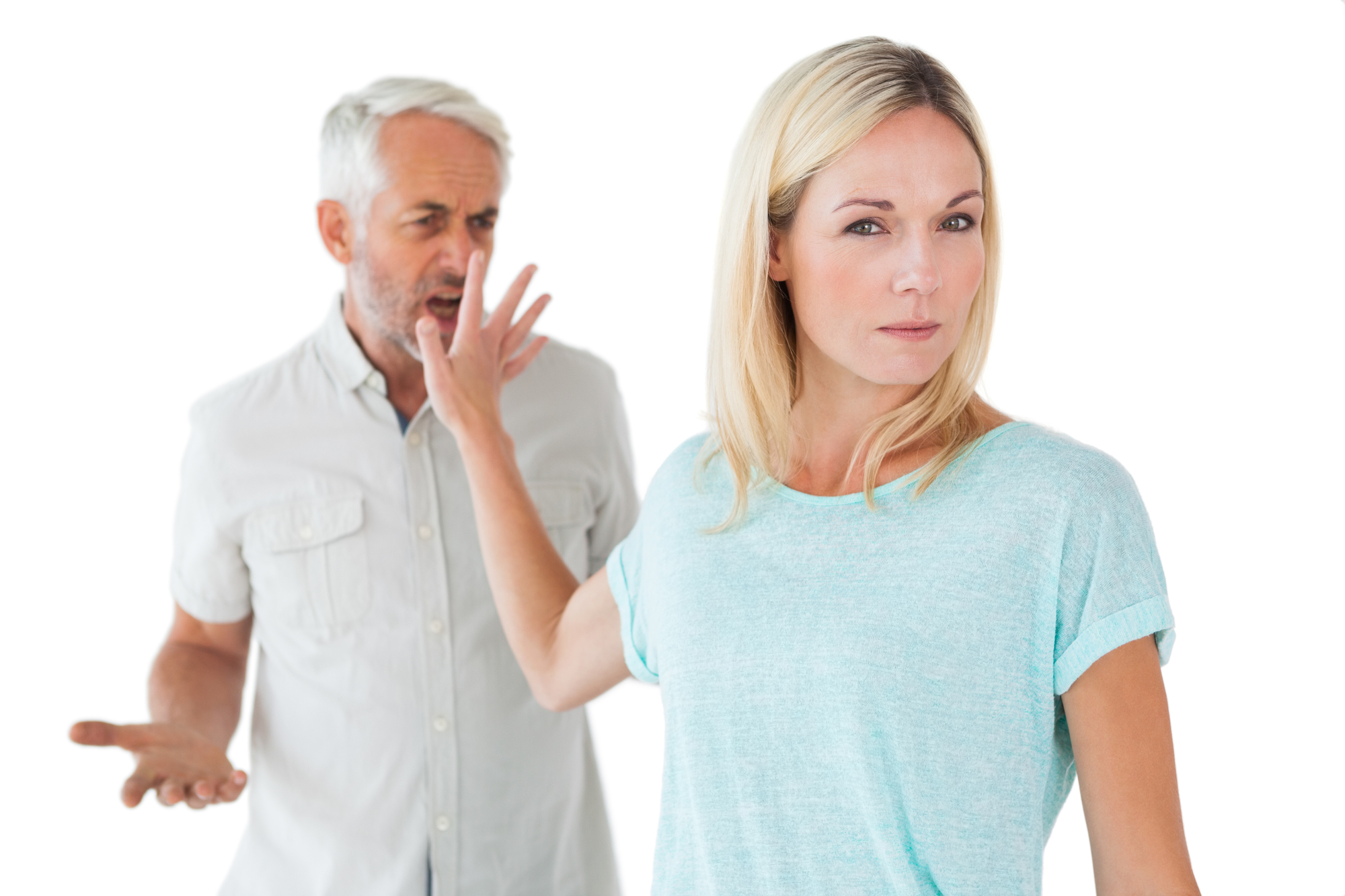 Woman not listening to her angry partner on white background