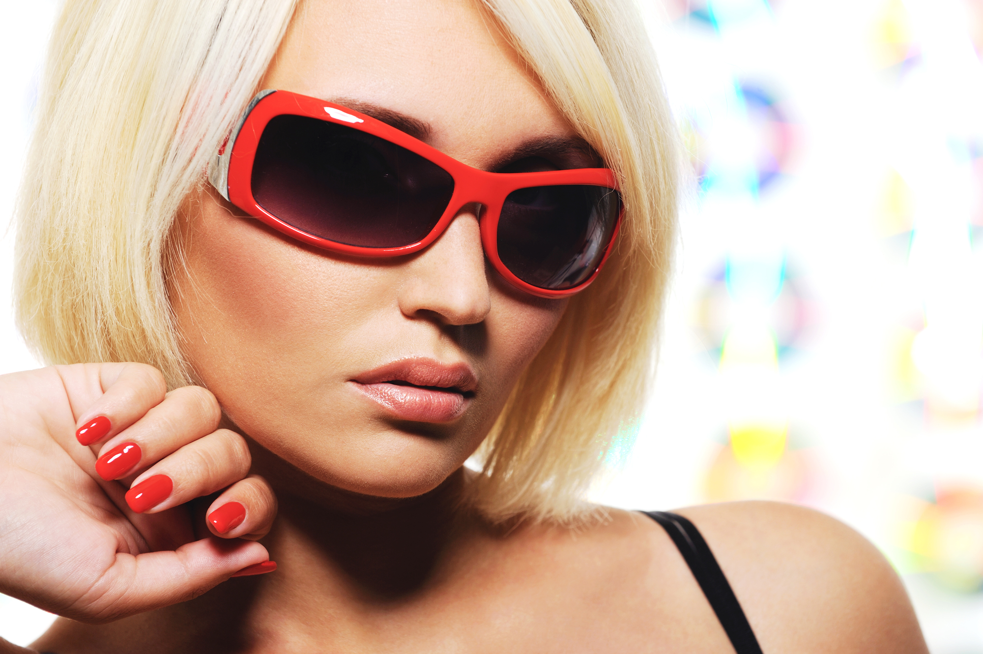glamour view of beautiful woman with red sunglasses - close-up portrait