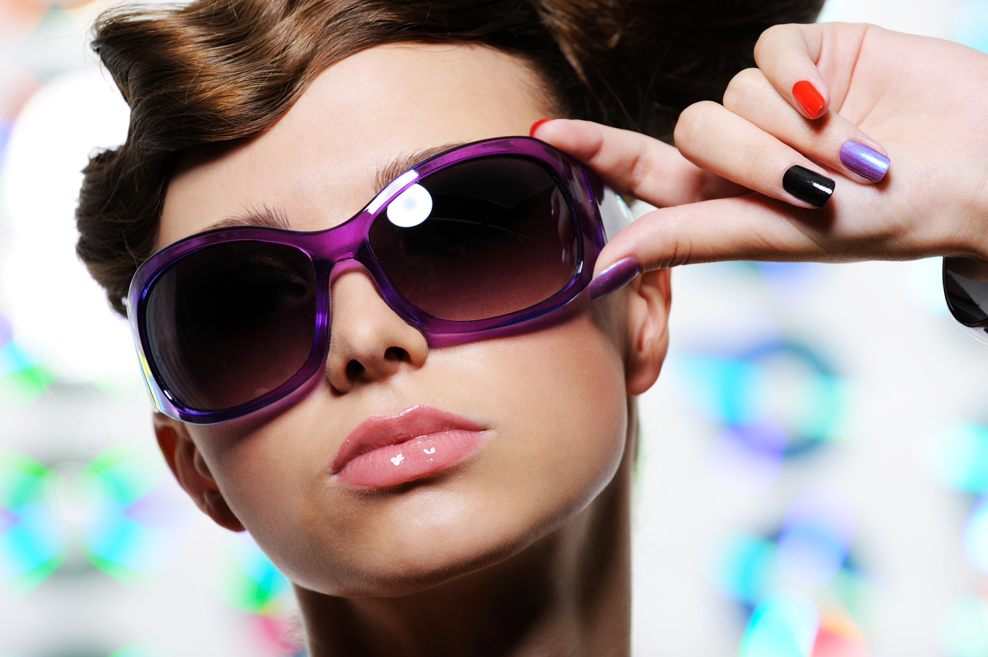 fashion stylish sunglasses on the beautiful female face - close-up