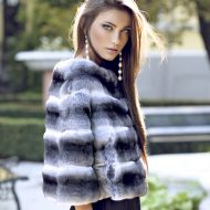Beautiful woman posing in a chinchilla fur coat