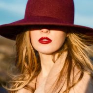 Portrait of elegant beautiful woman with red lips and hat