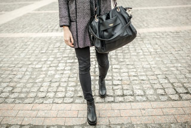 Close-up of unrecognizable woman wearing fashion clothes and bag.